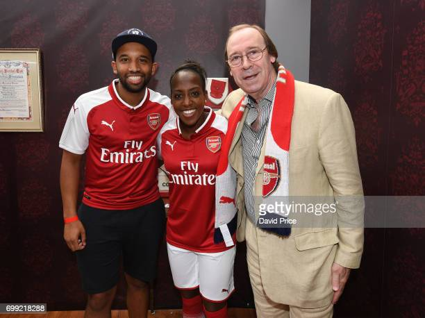 Danielle Carter of Arsenal Ladies and Former Arsenal player Charlie George pose with DJ Charlesy during new Arsenal Puma Home kit launch at King's...