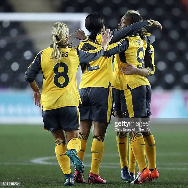 Danielle Carter of Arsenal Ladies FC is congratulated by her teammates after scoring her side's first goal during the FA WSL match between Liverpool...