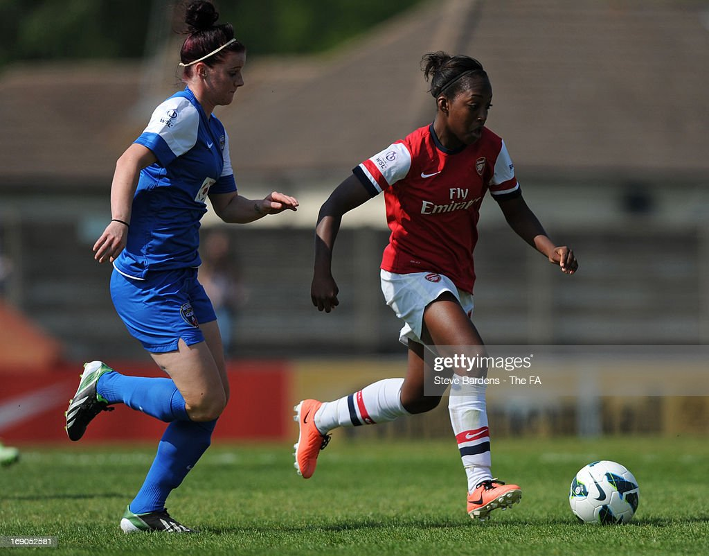 Danielle Carter of Arsenal Ladies FC takes on the Bristol Academy Women's FC defence during the FA WSL Continental Cup match between Arsenal Ladies FC and Bristol Academy at Meadow Park on May 19, 2013 in Borehamwood, England.
