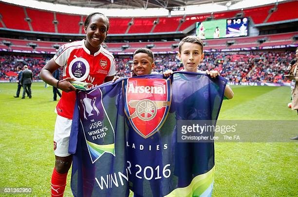 Danielle Carter of Arsenal receives the Player of the Match award by two young fans during the SSE Women's FA Cup Final between Arsenal Ladies and...