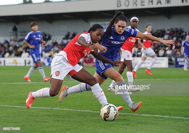 Danielle Carter of Arsenal takes on Claire Rafferty of Chelsea during the match between Arsenal Ladies and Chelsea Ladies at Meadow Park on August 23...