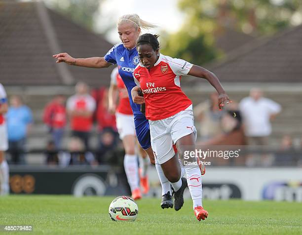 Danielle Carter of Arsenal takes on Katie Chapman of Chelsea during the match between Arsenal Ladies and Chelsea Ladies at Meadow Park on August 23...