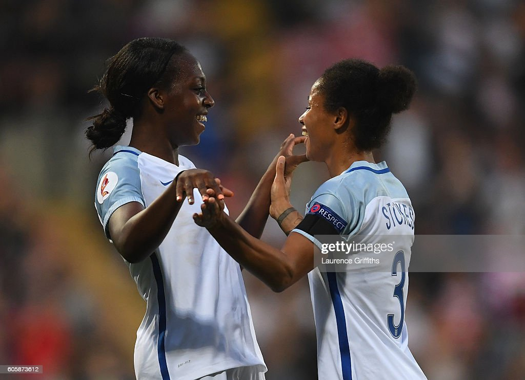 Danielle Carter (l) of England is congratulated on scoring her second goal by Demi Stokes during the UEFA Women's Euro 2017 Qualifier between England and Estonia at Meadow Lane on September 15, 2016 in Nottingham, England.
