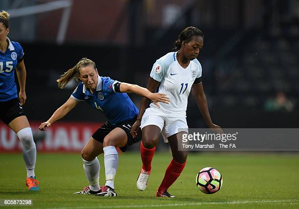 Danielle Carter of England is tackled by Pille Raadik of Estonia during the UEFA Women's Euro 2017 Qualifier match between England Women and Estonia...