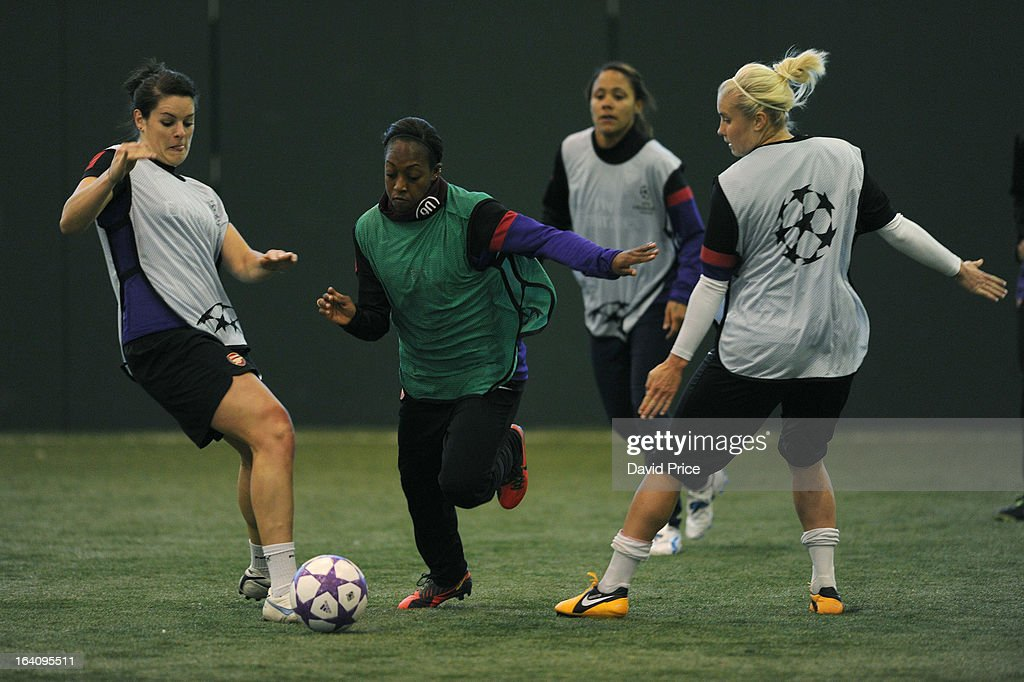 Danielle Carter skips past Jennifer Beattie and Steph Houghton of Arsenal Ladies during an Arsenal Ladies Training Session at Arsenal Training Ground on March 19, 2013 in St. Albans, Hertfordshire, England.