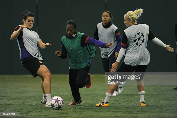 Danielle Carter skips past Jennifer Beattie and Steph Houghton of Arsenal Ladies during an Arsenal Ladies Training Session at Arsenal Training Ground...