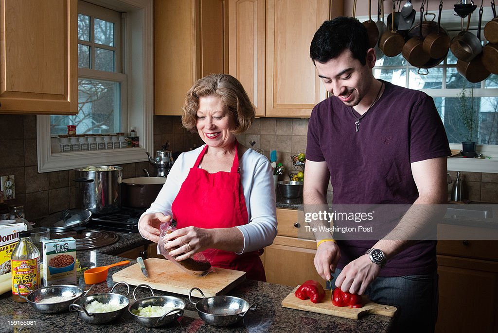 Danielle Cook Navidi, director of a cancer nutrition program at MedStar Georgetown and author of a cookbook aimed at families with children who have cancer, makes Red Bean and Rice Soup with her son, Fabien Navidi-Kasmai, 19, who is a cancer survivor.