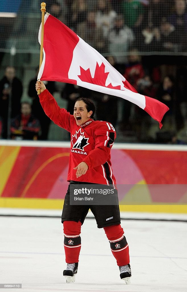 Danielle Goyette #15 of Canada waves a Canadian flag to celebrate their 4-1 victory over Sweden to win the gold medal in women's ice hockey during Day 10 of the Turin 2006 Winter Olympic Games on February 20, 2006 at the Palasport Olimpico in Turin, Italy.