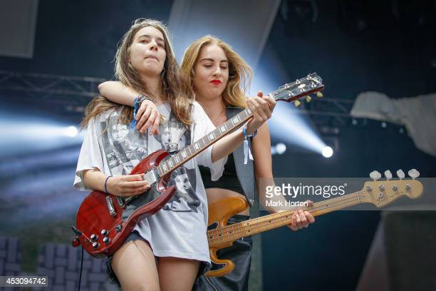 Danielle Haim and Este Haim perform with Haim on Day 2 of the Osheaga Music and Art Festival on August 2 2014 in Montreal Canada
