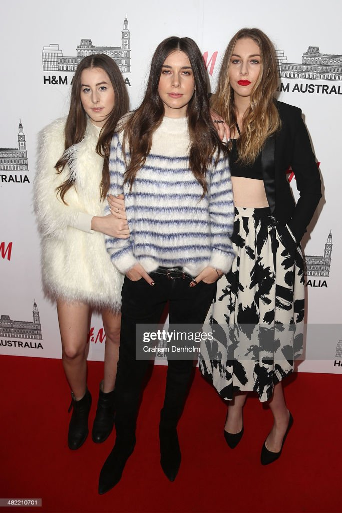 Danielle Haim Este Haim and Alana Haim of the band Haim attend the VIP launch party for HM Australia at the GPO on April 3 2014 in Melbourne Australia