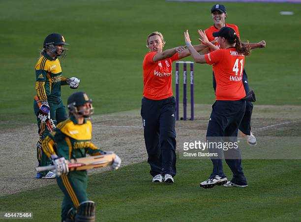 Danielle Hazel of England celebrates taking the wicket of Dane van Niekerk of South Africa with her team mates during the NatWest Women's...