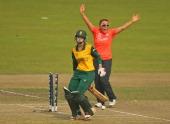 Danielle Hazell of England celebrates as Dane van Niekerk of South Africa is run out during the ICC Women's World Twenty20 Bangladesh 2014 2nd...