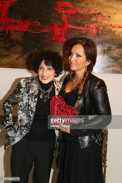 Danielle Hermann of the Fondation Cardiovasculaire and Helene Segara attend the Antiquites Gallery Cocktail to the Benefit of Fondation...