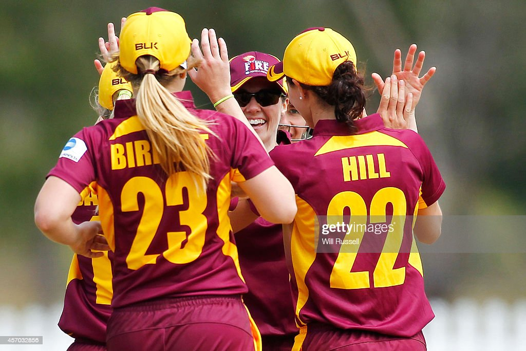 Danielle Hollis of The Queensland Fire celebrates after taking a catch off Piepa Cleary of The Western Fury during the WNCL match between Western...
