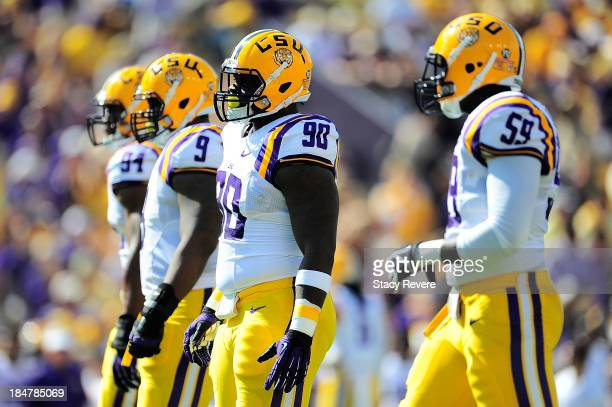 Danielle Hunter Ego Ferguson Anthony Johnson and Jermauria Rasco of the LSU Tigers wait for action against the Florida Gators during a game at Tiger...