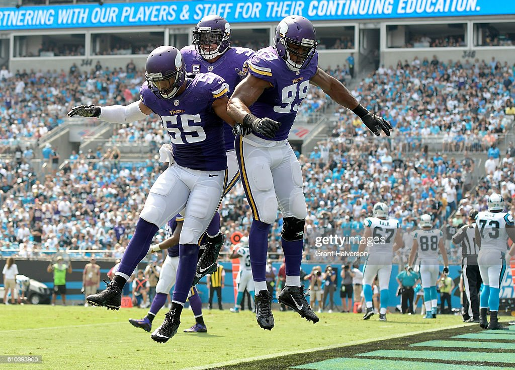 Danielle Hunter #99 of the Minnesota Vikings celebrates with teammates after sacking Cam Newton #1 of the Carolina Panthers for a safety during the game at Bank of America Stadium on September 25, 2016 in Charlotte, North Carolina.