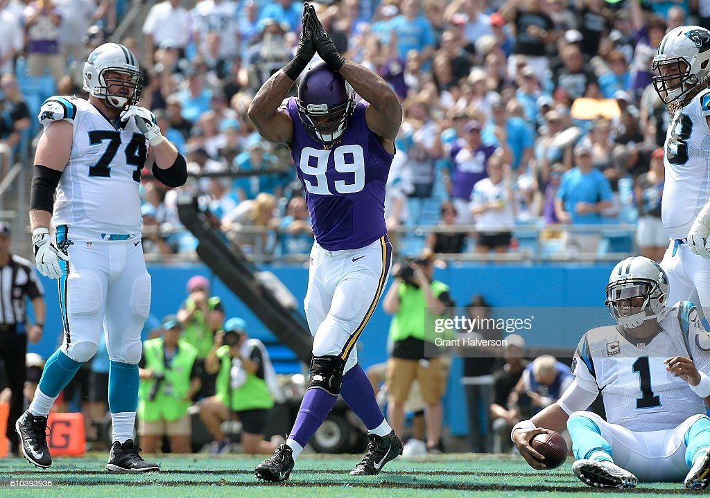 Danielle Hunter #99 of the Minnesota Vikings reacts after sacking Cam Newton #1 of the Carolina Panthers for a safety during the game at Bank of America Stadium on September 25, 2016 in Charlotte, North Carolina.