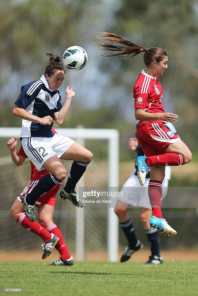 Danielle Johnson of Melbourne competes with Georgia Macri of Adelaide during the round seven W-League match between Adelaide United and the Melbourne Victory at Burton Park on December 1, 2012 in Adelaide, Australia.