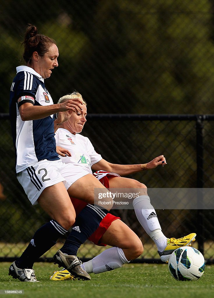 Danielle Johnson of the Victory and Kristy Moore of Adelaide contest the ball during the round 11 W-League match between the Melbourne Victory and Adelaide United at Wembley Park on January 5, 2013 in Melbourne, Australia.