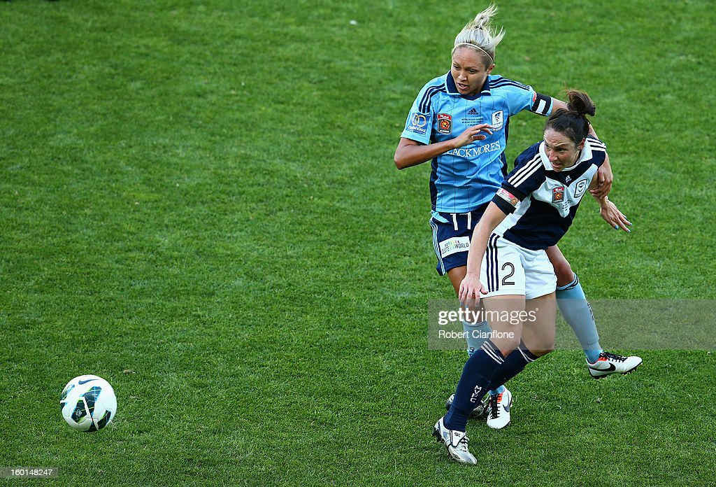 Danielle Johnson of the Victory is challenged by Kyah Simon of Sydney FC during the W-League Grand Final between the Melbourne Victory and Sydney FC at AAMI Park on January 27, 2013 in Melbourne, Australia.