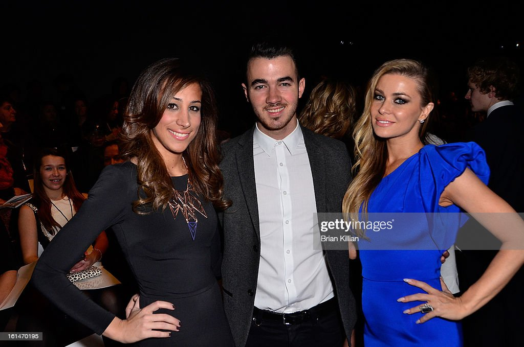 Danielle Jonas, <a gi-track='captionPersonalityLinkClicked' href=/galleries/search?phrase=Kevin+Jonas&family=editorial&specificpeople=709547 ng-click='$event.stopPropagation()'>Kevin Jonas</a>, and <a gi-track='captionPersonalityLinkClicked' href=/galleries/search?phrase=Carmen+Electra&family=editorial&specificpeople=171242 ng-click='$event.stopPropagation()'>Carmen Electra</a> attend Pamella Roland during Fall 2013 Mercedes-Benz Fashion Week at The Studio at Lincoln Center on February 11, 2013 in New York City.