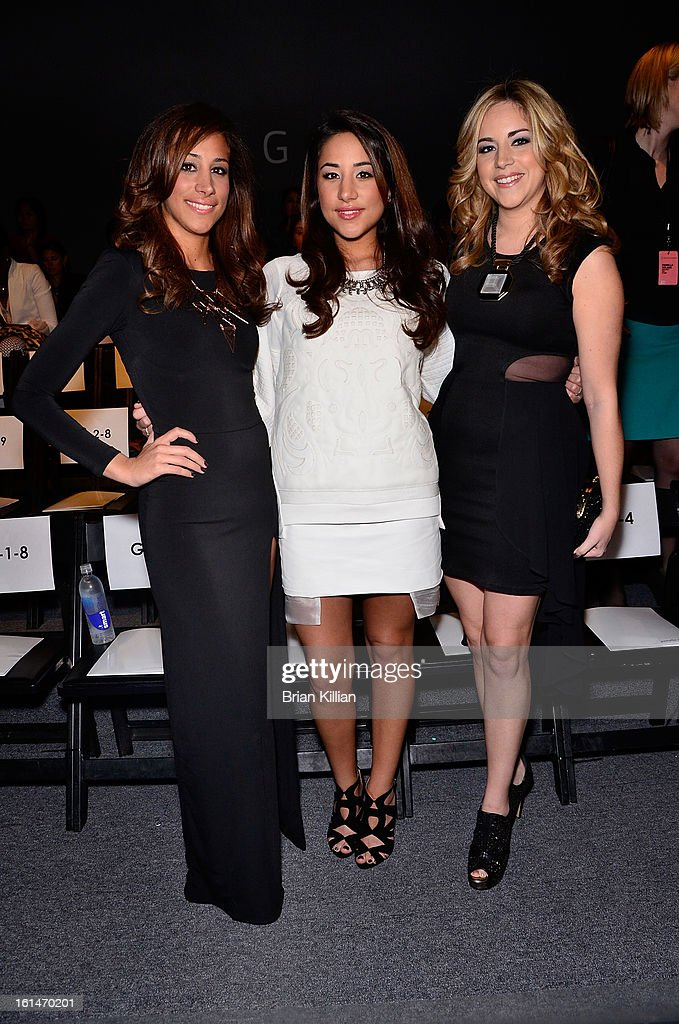 Danielle Jonas poses with her two sisters, Katie Deleasa and Dina Deleasa during the Pamella Roland during Fall 2013 Mercedes-Benz Fashion Week at The Studio at Lincoln Center on February 11, 2013 in New York City.