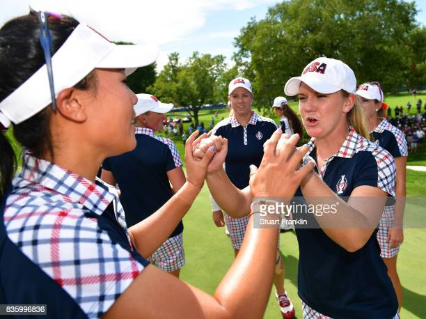 Danielle Kang and Austin Ernst of Team USA celebrate after the final day singles matches of The Solheim Cup at Des Moines Golf and Country Club on...
