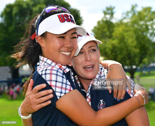 Danielle Kang and Cristie Kerr of Team USA celebrate afterthe final day singles matches of The Solheim Cup at Des Moines Golf and Country Club on...