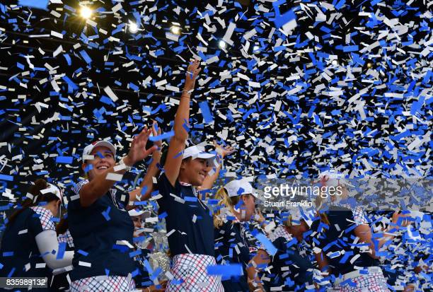 Danielle Kang and Cristie Kerr of Team USA celebrate during the closing ceremony after the final day singles matches of The Solheim Cup at Des Moines...