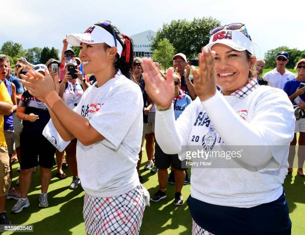 Danielle Kang and Lizette Salas of Team USA clap in celebration of victory over Team Europe during the final day singles matches of the Solheim Cup...