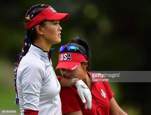 Danielle Kang bites the wrist of Michelle Wie of Team USA during practice for The Solheim Cup at the Des Moines Country Club on August 15 2017 in...