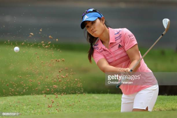 Danielle Kang chips from the bunker onto the ninth green during the third round of the LPGA LOTTE Championship Presented By Hershey at Ko Olina Golf...