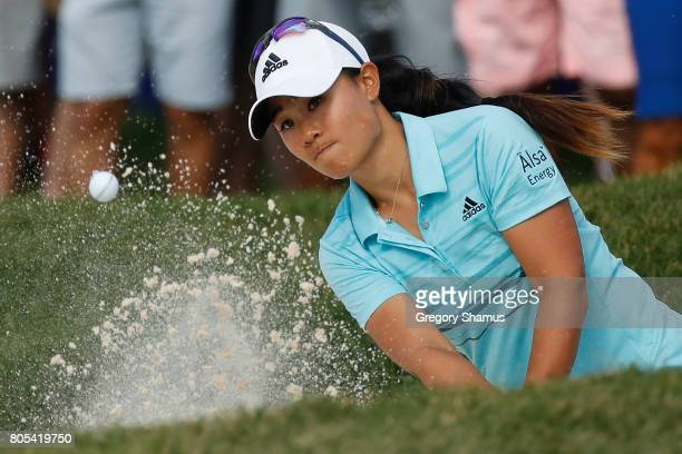 Danielle Kang hits from a green side sand trap to the 18th green during the third round of the 2017 KPMG PGA Championship at Olympia Fields Country...