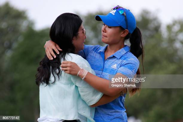 Danielle Kang hugs her mom Grace Lee after winning the the 2017 KPMG PGA Championship at Olympia Fields Country Club on July 2 2017 in Olympia Fields...
