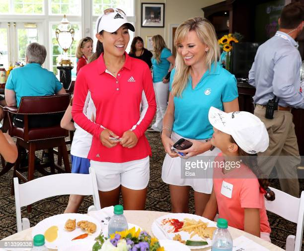 Danielle Kang meets attendees of the Girls Golf VIP Experience by Prudential during the US Women's Open preview day 3 on July 12 2017 at Trump...