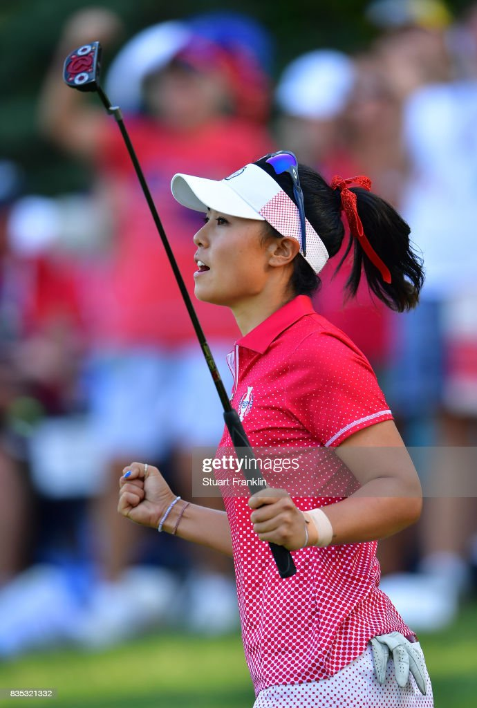 Danielle Kang of Team USA celebrates a putt during the afternoon fourball matches of The Solheim Cup at Des Moines Golf and Country Club on August 18, 2017 in West Des Moines, Iowa.