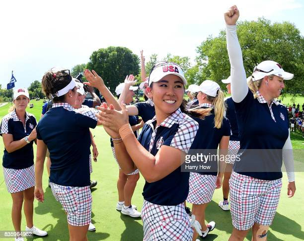 Danielle Kang of Team USA celebrates victory over Team Europe during the final day singles matches of the Solheim Cup at the Des Moines Golf and...