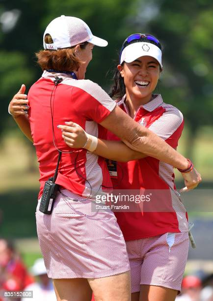 Danielle Kang of Team USA celebrates with Team USA Captain Juli Inkster after winning her match during the morning foursomes matches of The Solheim...