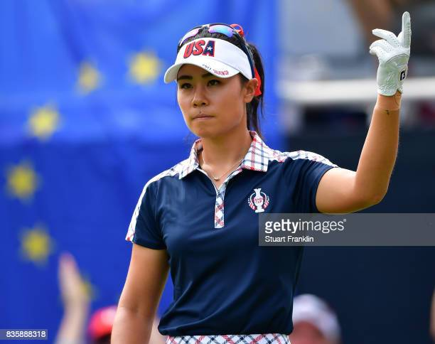 Danielle Kang of Team USA gestures during the final day singles matches of The Solheim Cup at Des Moines Golf and Country Club on August 20 2017 in...