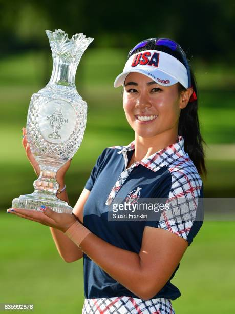 Danielle Kang of Team USA holds the Solheim Cup trophy after the final day singles matches of The Solheim Cup at Des Moines Golf and Country Club on...