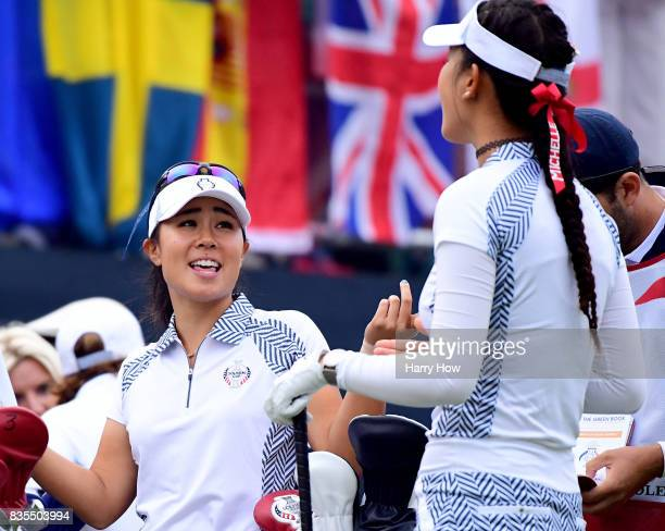 Danielle Kang of Team USA laughs with Michelle Wie on the first tee during the morning foursomes matches of the Solheim Cup at the Des Moines Golf...