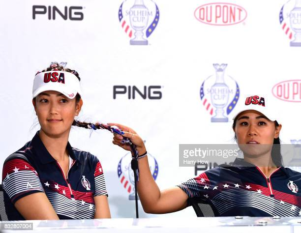 Danielle Kang of Team USA plays with the hair of Michelle Wie as they field questions during press conference for the Solheim Cup at the Des Moines...