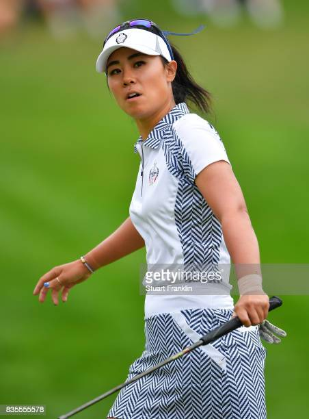 Danielle Kang of Team USA reacts to a putt during the second day morning foursomes matches of The Solheim Cup at Des Moines Golf and Country Club on...