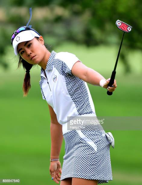 Danielle Kang of Team USA reacts to her missed birdie putt on the 12th green during the morning foursomes matches of the Solheim Cup at the Des...