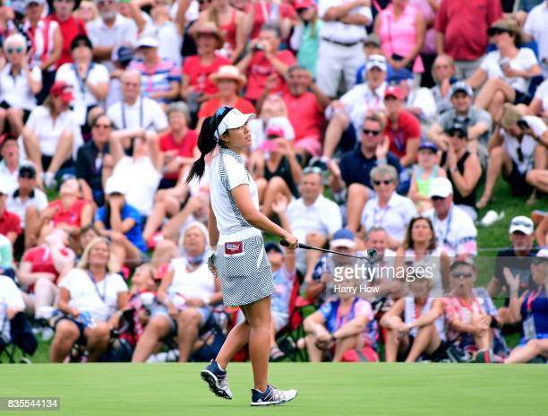 Danielle Kang of Team USA reacts to her missed putt on the 17th green to lose two and one to Team Europe during the morning foursomes matches of the...