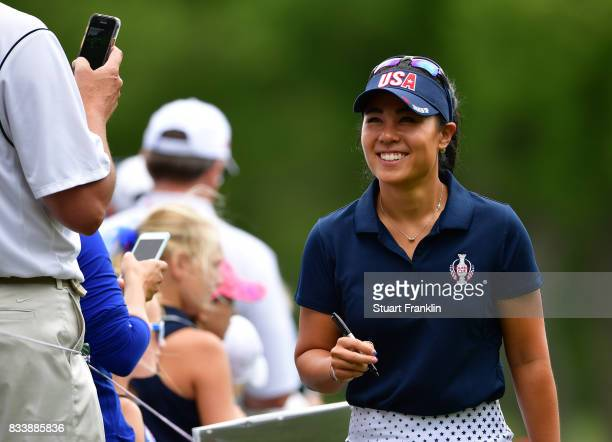 Danielle Kang of Team USA signs autographs for fans during practice prior to The Solheim Cup at Des Moines Golf and Country Club on August 17 2017 in...