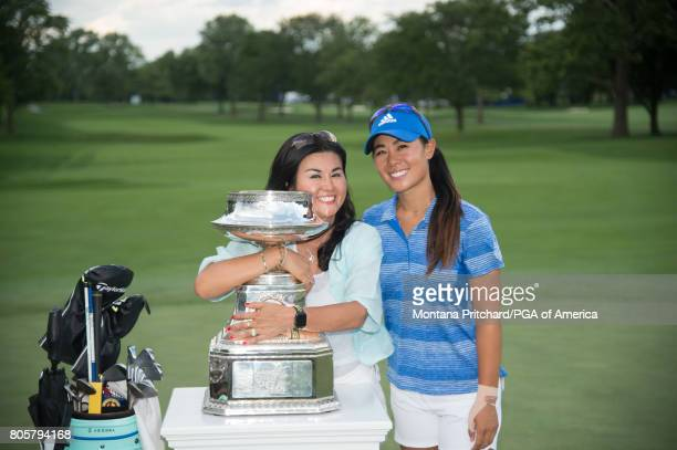 Danielle Kang of the United States and her mother Grace Lee gather for a photo with the trophy for the 2017 KPMG Women's PGA Championship held at...