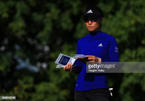 Danielle Kang of the United States prepares for her tee shot on the 4th hole during round one of the Canadian Pacific Women's Open at the Ottawa Hunt...