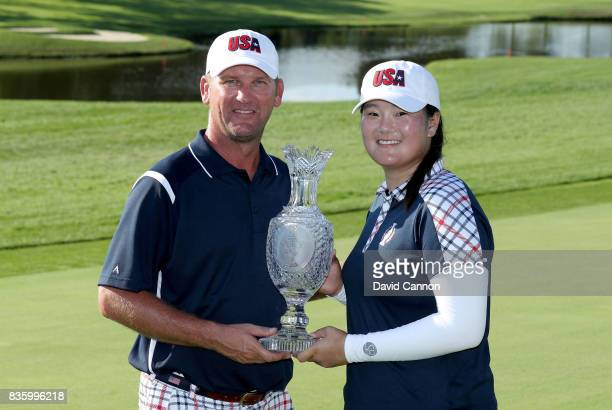 Danielle Kang of the United States Team holds the Solheim Cup after the closing ceremony with her caddie Jeff King during the final day singles...