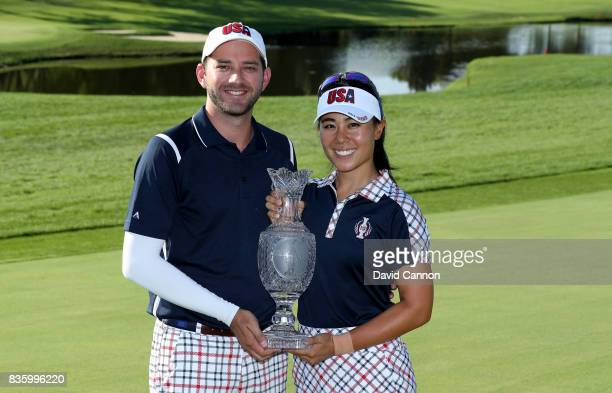 Danielle Kang of the United States Team holds the Solheim Cup with her caddie Cole Pensanti after the closing ceremony during the final day singles...